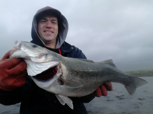 Darren with his first sea bass.